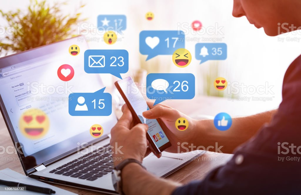 Social media concept. Like and share social media. Hands holding smartphone with social media network icons. Marketing concept. Agreement Stock Photo