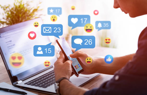 Social media concept. Like and share social media. Hands holding smartphone with social media network icons. Marketing concept. social issues stock pictures, royalty-free photos & images