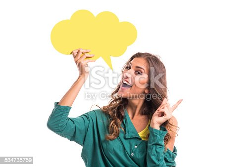 Young girl holding yellow speech bubble, isolated on white background.