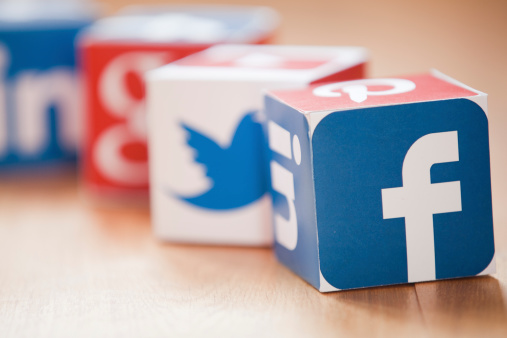 London, United KIngdom- February 3, 2014: Social media logos printed onto handmade cubes. Logos include Facebook, linkedin, twitter. Social media uses web and mobile technology to connect people