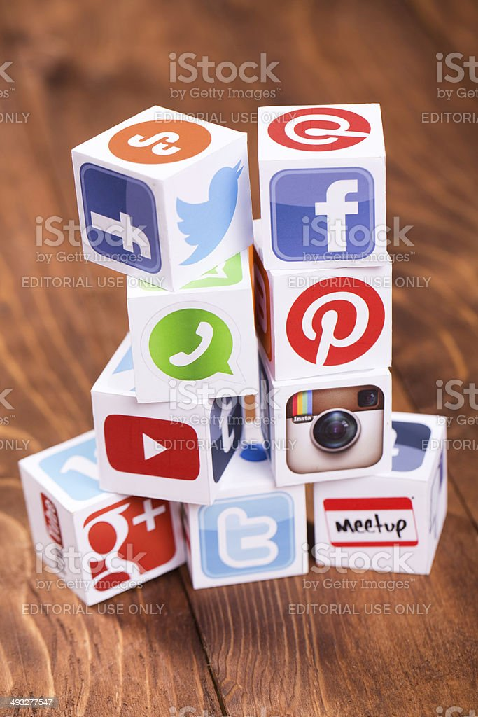 Social media cubes on a wooden background royalty-free stock photo