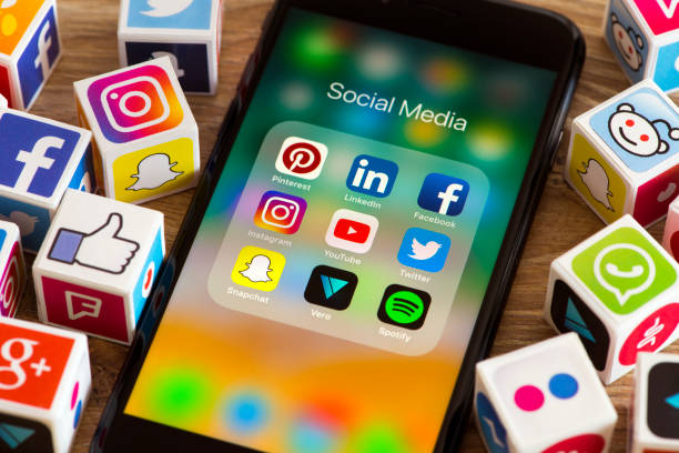 Social media cubes İstanbul, Turkey - August 25, 2018: Plastic cubes with popular social media services icons, including Facebook, Instagram, Youtube, Twitter and an Apple iPhone 8 smart phone on an desk. social issues stock pictures, royalty-free photos & images