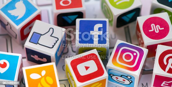 İstanbul, Turkey - May 24, 2018: Plastic cubes with popular social media services icons, including Facebook, Instagram, Youtube, Twitter on an Apple iMac computer keyboard.