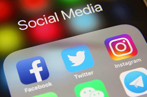 London, UK - 02 06 2019: Apple iPhone 6s screen with social media icons applications Facebook, Twitter, Instagram, WhatsApp, WeChat, Telegram, Skype, Youtube, Snapchat etc.