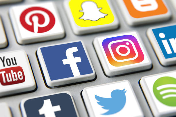 Social media icons internet app application London, UK - 03 17 2019: Social media icons printed and placed on computer keyboard applications Facebook, Twitter, Instagram, Youtube, Pinterest, Snapchat etc. social networking stock pictures, royalty-free photos & images