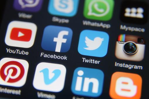 Berlin, Germany - 10 10 2015: Apple iPhone 6 screen with social media internet application icons Facebook, Twitter, Instagram, LinkedIn, Vimeo, Youtube, Skype, Blogger,  Pinterest etc.