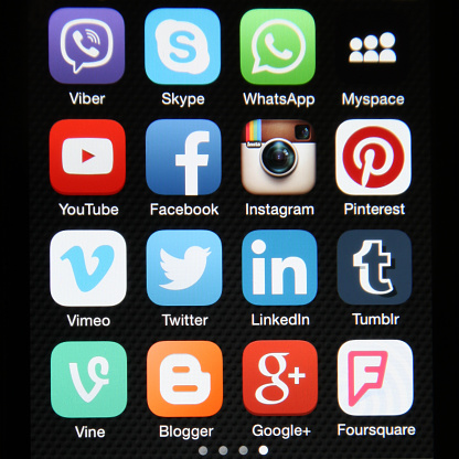 Berlin, Germany - 07 16 2015: Apple iPhone 6 screen with social media icons internet applications Facebook,