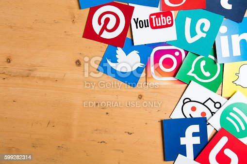 London, United Kingdom - September 5, 2016: Popular social media logos printed onto paper on a wooden background