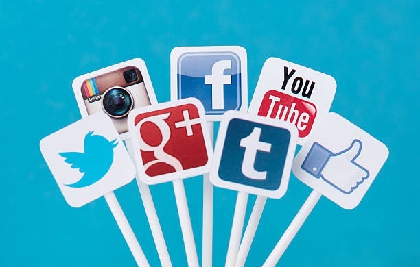 Social media icons on plastic signs stock photo