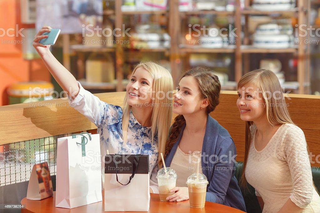 Social media in women shopping stock photo