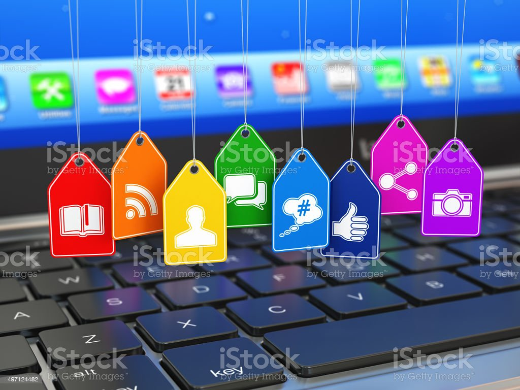 Social media internet communication concept. Laptop and signs of stock photo