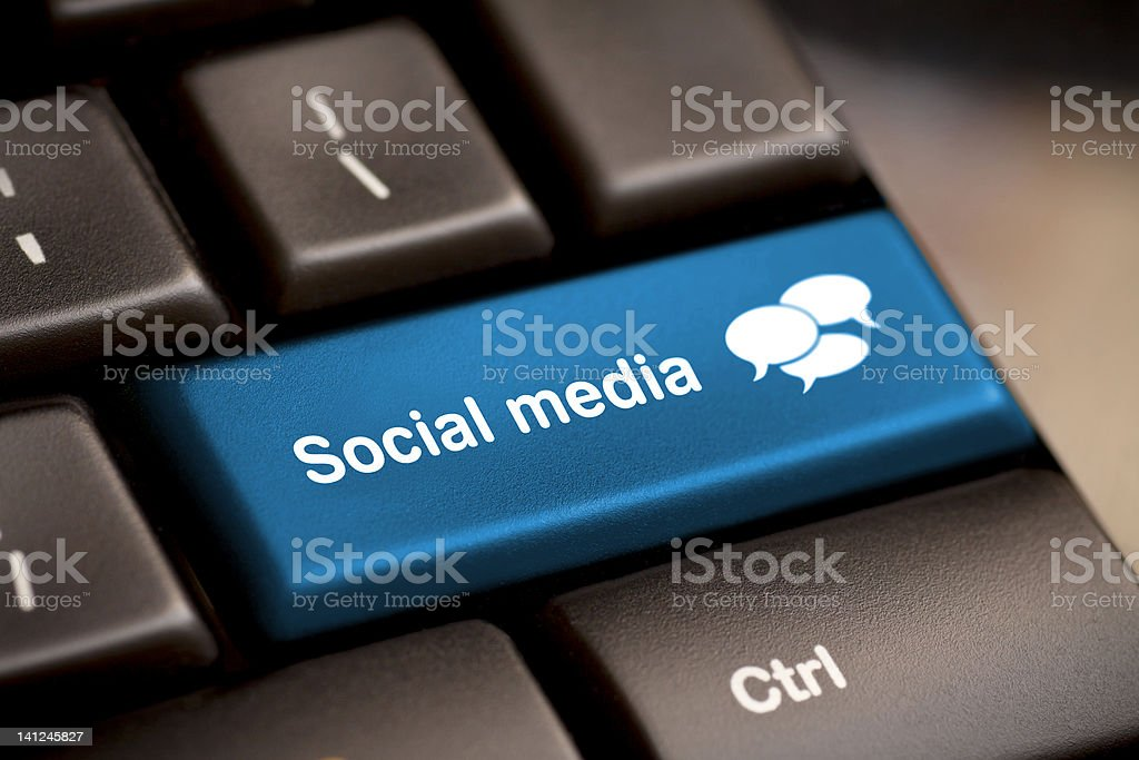 Social media keyboard for chatting Social Media button on a keyboard with speech bubbles. Blue Stock Photo