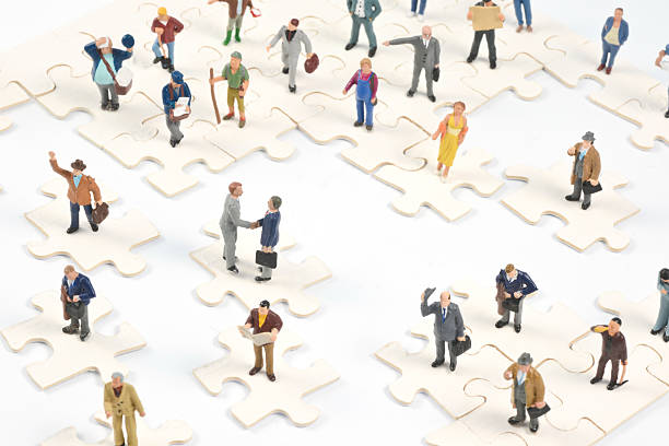 social media little people on puzzle pieces - figurine stock photos and pictures