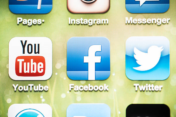 Social Media Logos on iPhone 4 screen stock photo