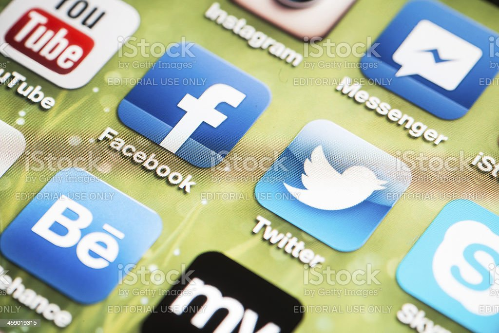 Social Media Logos on iPhone 4 screen royalty-free stock photo