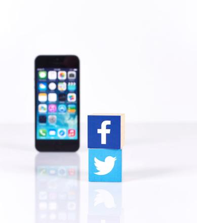 istock Social Media Logos with iPhone5 509392699