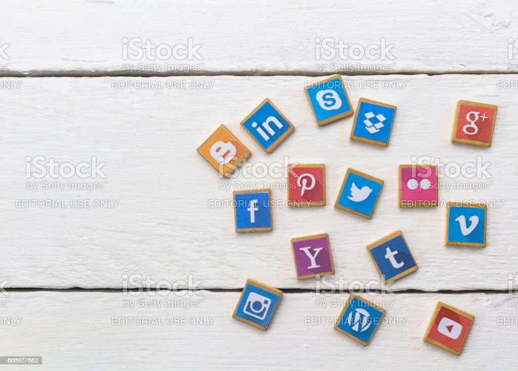 Social Media logotype popular collection printed and place on wood scrabble game pieces isolated on white wood planks stock photo