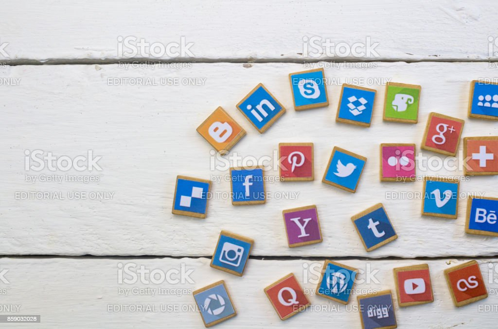 QUEENSTOWN, SOUTH AFRICA - 09 APRIL 2017: Social Media logotype popular collection printed and place on wood scrabble game pieces isolated on white wood planks stock photo