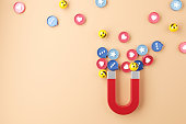 istock Social media marketing concept. Attracting (emoji, like, love, star, comment icon) with a huge magnet. 1279731687