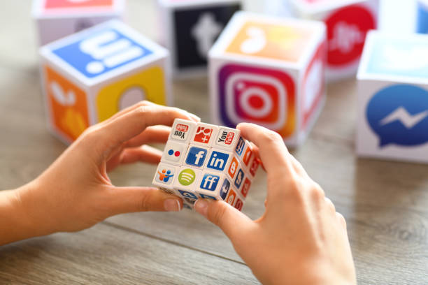 social-media puzzle cube - editorial stock-fotos und bilder