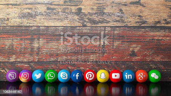 istock Social media services icons on a wooden desk 1063448162