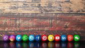 Social media services icons on a wooden desk