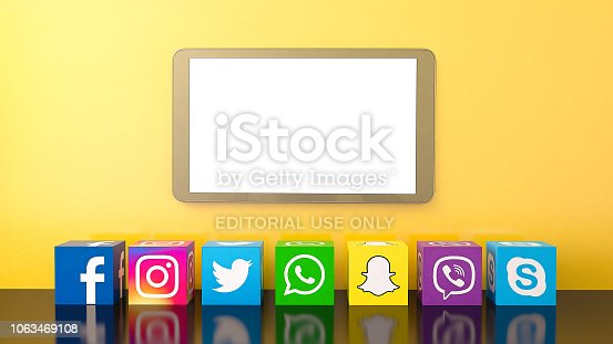 Istanbul, Turkey - November 05, 2018: Cube shape of popular social media services icons, including Facebook, Instagram, Twitter, Whatsapp, Snapchat, Viber, Skype on yellow background