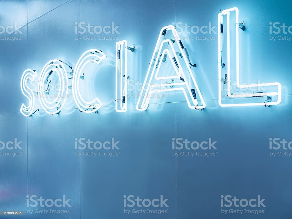 Social Media Type font Neon sign light Signage on wall stock photo