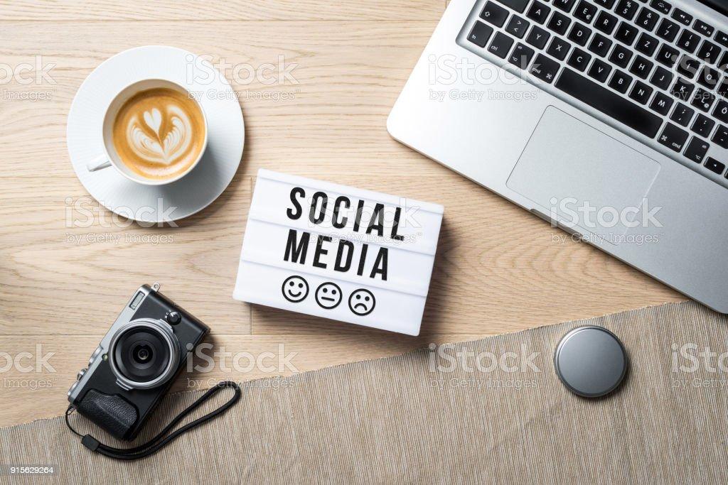 Social media written on lightbox in office as flatlay stock photo