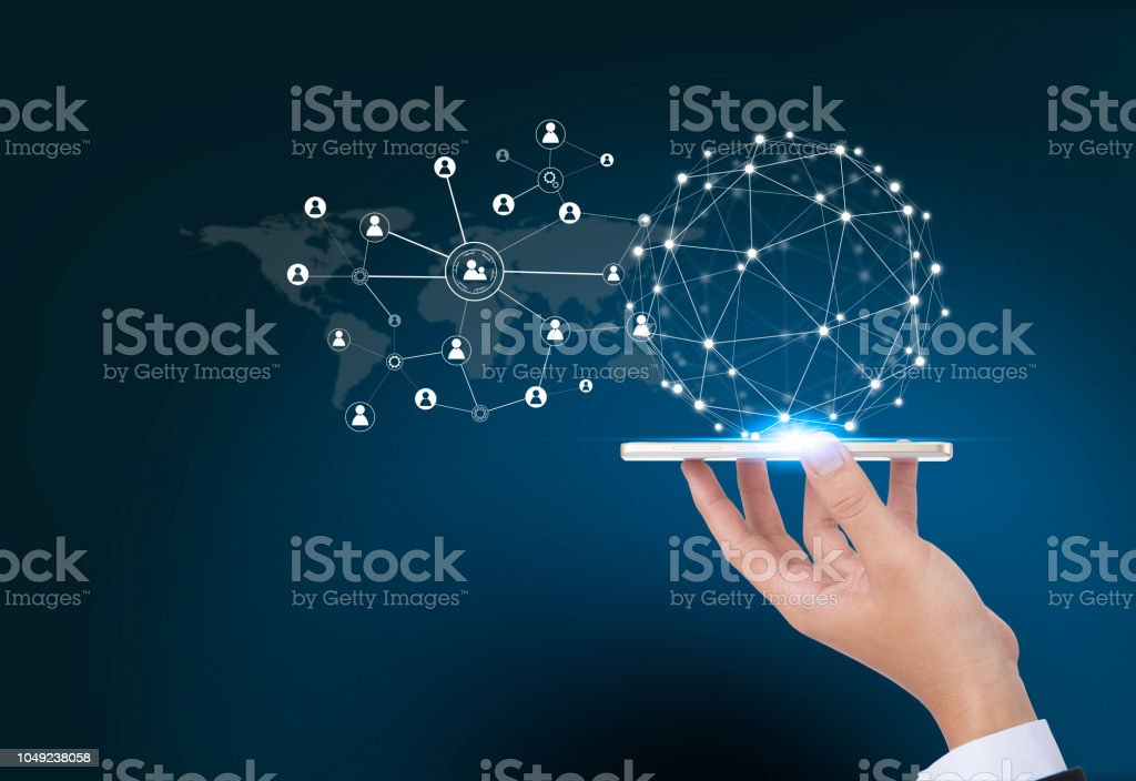 Social media,social network concept with smart phone on business hand with dark blue background. stock photo