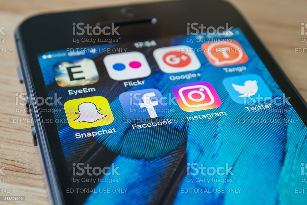 Social Network Applications Bangkok, Thailand - June 8, 2016 : Apple iPhone5s showing its screen with popular social network applications. Apple Computers Stock Photo
