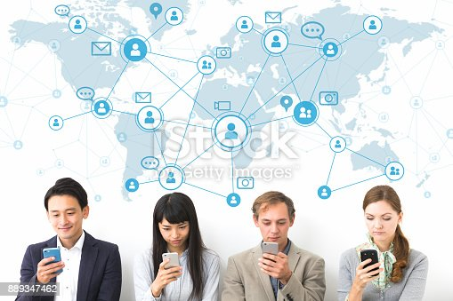 istock Social network concept. Group of people using smart phone. 889347462