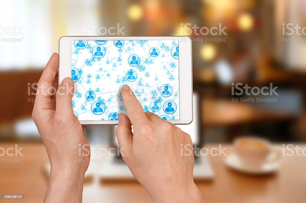 Social network with a tablet inside internet cafe royalty-free stock photo