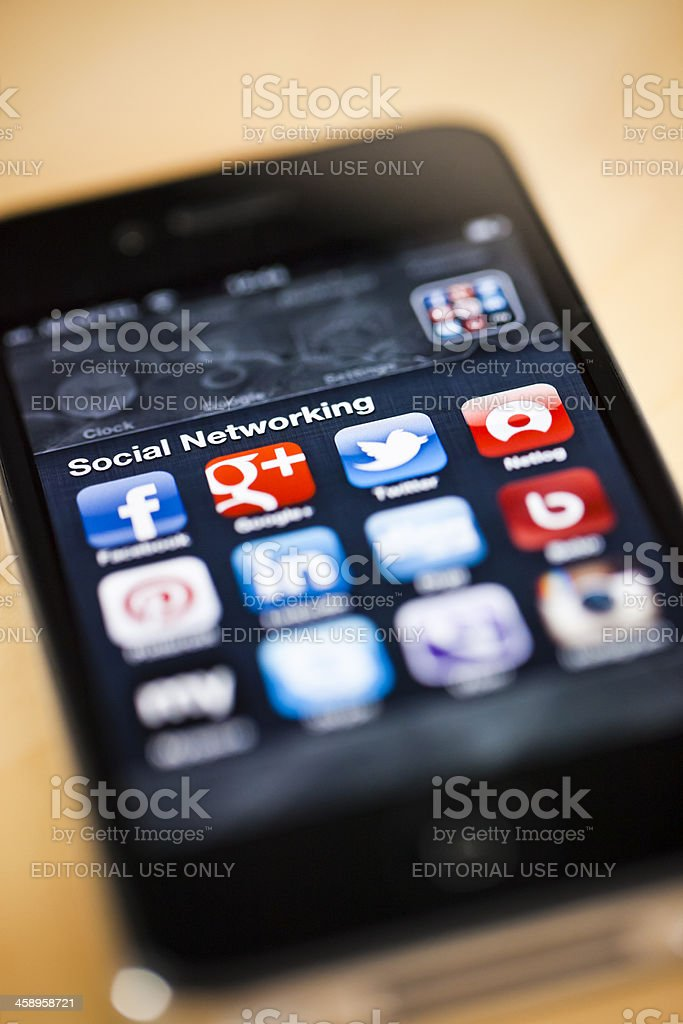 Social networking apps on iPhone 4 royalty-free stock photo