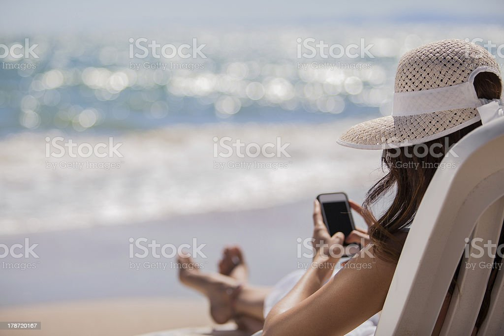 Social networking at the beach stock photo