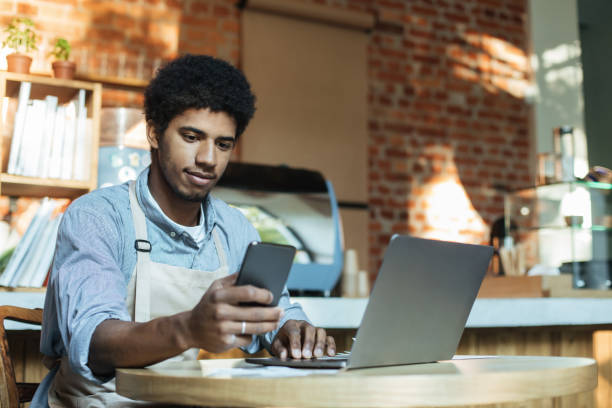 Social networking, devices and small business during covid-19 pandemic stock photo