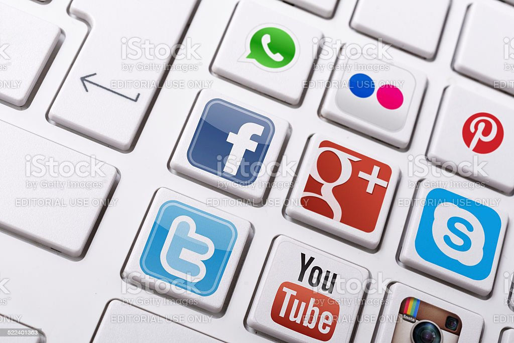 Social networking - facebook, twitter, instagram logos on keyboard menu stock photo
