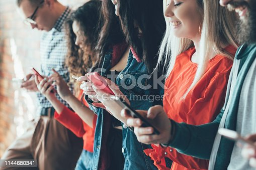 Always connected. Social networking. Excited millennials with smartphones. Surfing and chatting. Digital communication.