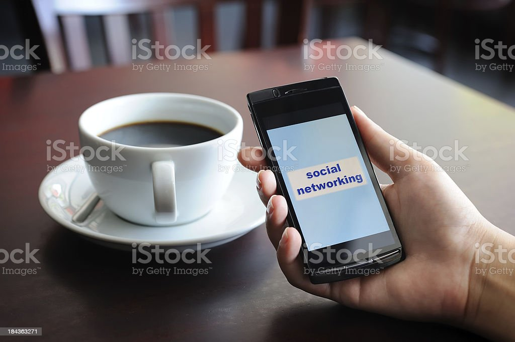 Social networking with mobile phone stock photo