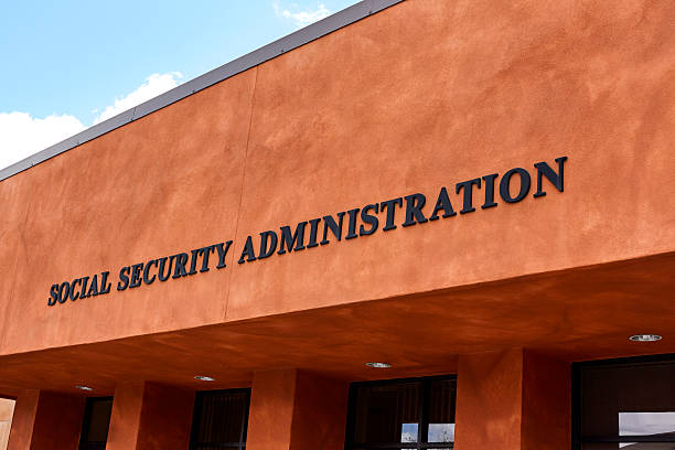 Social Security Administration Sign Sign on front of government building reading Social Security Administration social security stock pictures, royalty-free photos & images