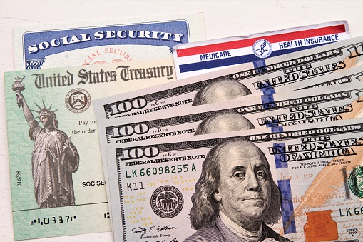 Social Security And Medicare Cards Treasury Check Hundred Dollar Bills Stock Photo - Download Image Now