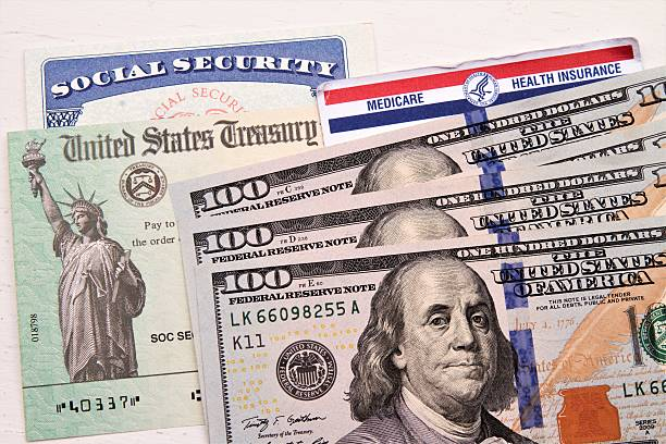 social security and medicare cards, treasury check, hundred dollar bills - social security check stock photos and pictures