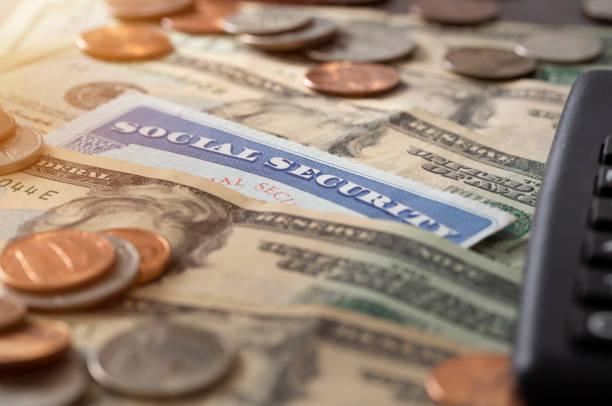 Social Security and Medicare Cost Social security and medicare concept with social security card and pile of money. nest egg stock pictures, royalty-free photos & images
