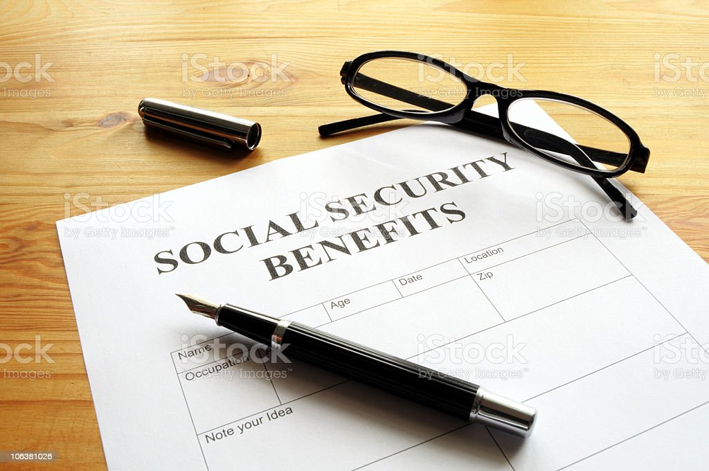 Social security benefits form with a black pen stock photo