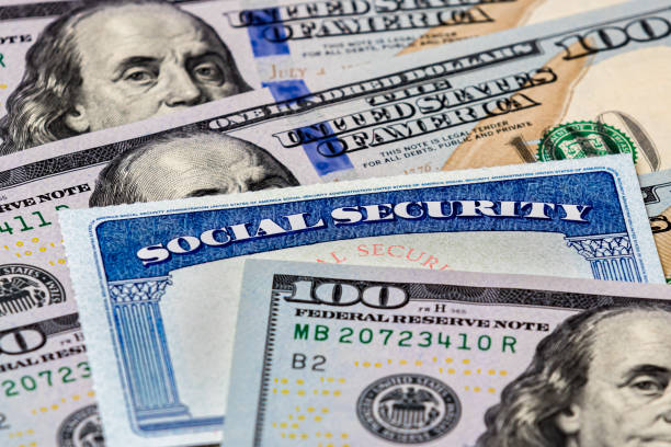 Social Security benefits identification card with 100 dollar bills closeup, background, copy space stimulus check stock pictures, royalty-free photos & images
