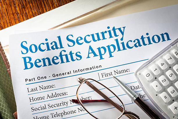 Social Security Benefits Social Security Benefits form with pen, glasses, and calculator social security stock pictures, royalty-free photos & images