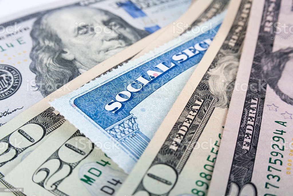 Social security card and American money dollar bills stock photo