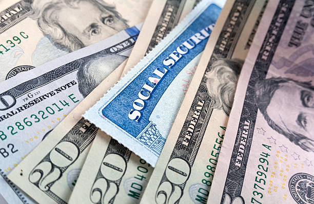 social security card and american money dollar bills - social security check stock photos and pictures