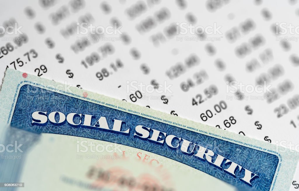 USA Social Security Card on calculations of income for retirement stock photo
