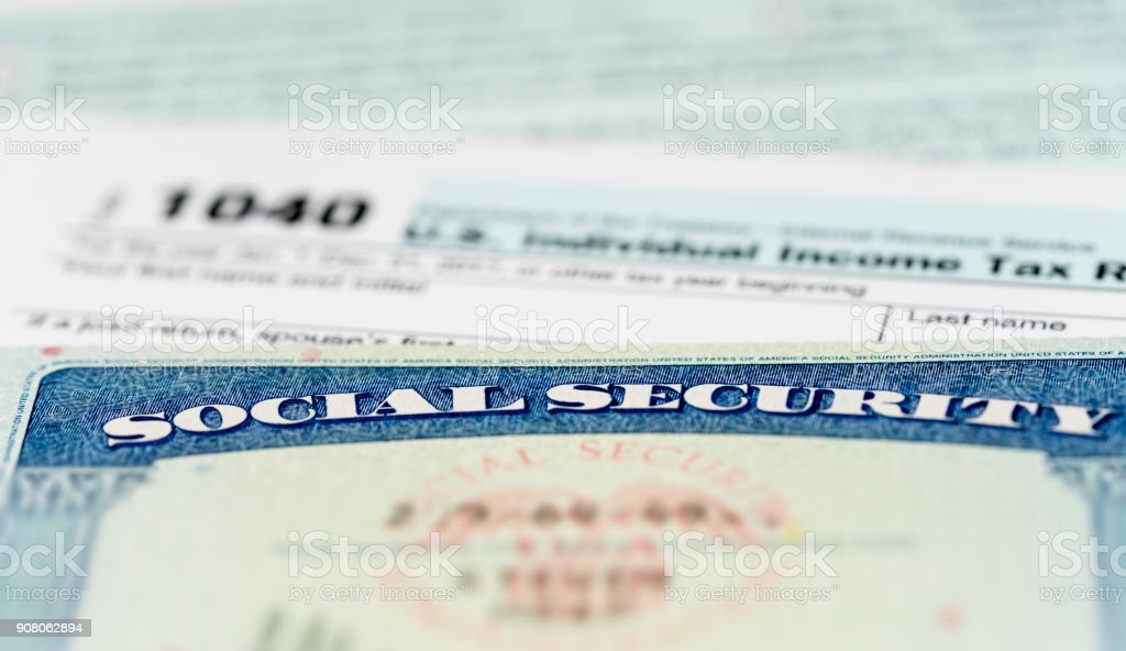 USA Social Security Card on calculations of tax for retirement stock photo